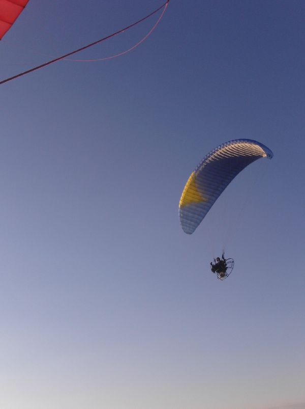 Chris Miller flies his paramotor just above me